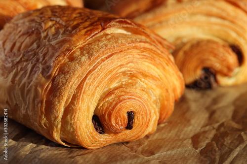Fotografija Freshly backed french chocolate croissant - petit pain au chocolat shiny in the