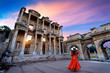 canvas print picture - Woman standing in Celsus Library at Ephesus ancient city in Izmir, Turkey.
