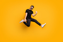 Full Body Profile Photo Of Crazy Hipster Guy Jumping High Holding Imagine Solo Guitar Music Lover Wear Sun Specs Black T-shirt Pants Isolated Yellow Color Background