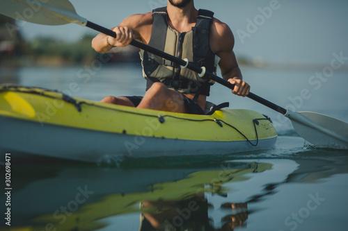 Fotografie, Obraz  Handsome Young Man Kayaking