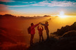 mother with kids -son and daughter - enjoy travel in sunset mountains
