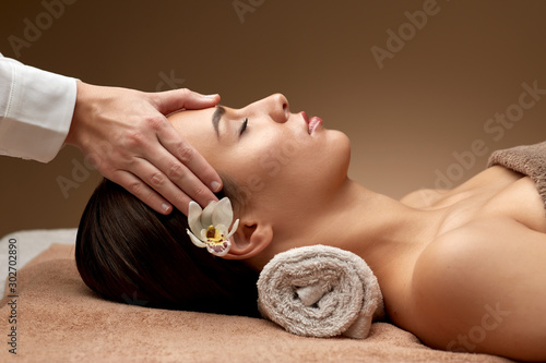 wellness, beauty and relaxation concept - beautiful young woman lying with close Wallpaper Mural