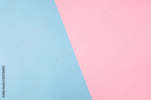 Obraz Photo of shared divided into two parts background harmonically soft pastel colored empty space for filling text idea banner billboard pink and blue colors - fototapety do salonu