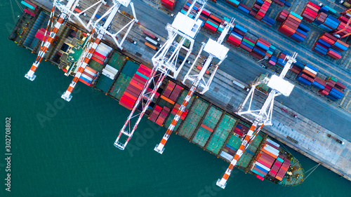 Foto auf Leinwand Shanghai Container ship carrying container for business freight shipping import and export, Aerial view container ship arriving in commercial port.