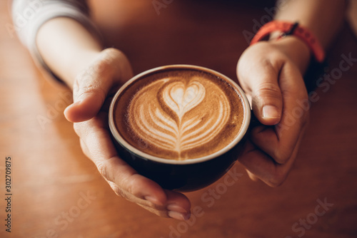 Close up Cup of coffee latte in coffee shop Poster Mural XXL