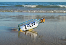 Happy New Year 2020, Message In A Bottle On The Beach