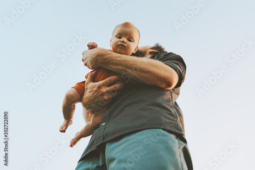 Fototapeta Father holding infant baby family lifestyle dad and child walking together parenthood childhood concept Fathers day holiday bottom view obraz na płótnie
