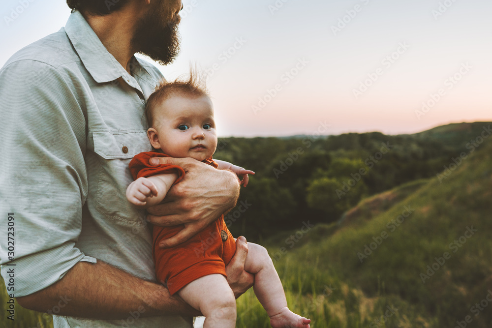 Fototapeta Father walking with baby outdoors family lifestyle dad and child together summer vacations parenthood childhood concept Fathers day holiday