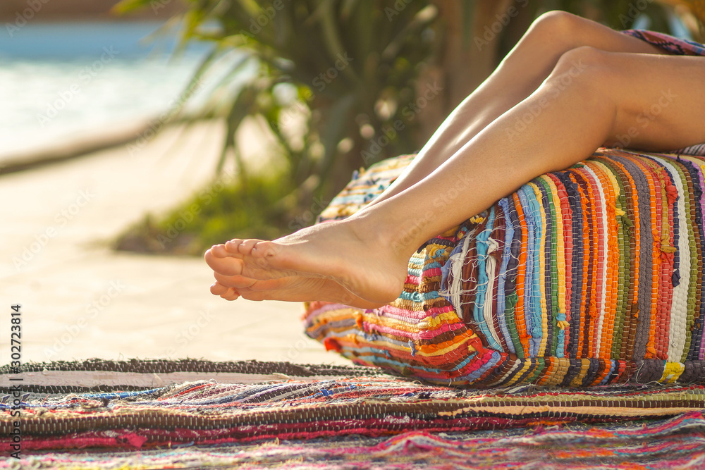 Fototapety, obrazy: Barefoot legs of carefree woman relaxing