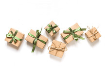 Christmas Zero Waste, Environmentally Friendly Packaging. Flat Lay Packs Gifts  Kraft Paper  Green Ribbon  White Background, Ecological Christmas Holiday Concept, Eco Decor, Top View, Copy Space Frame