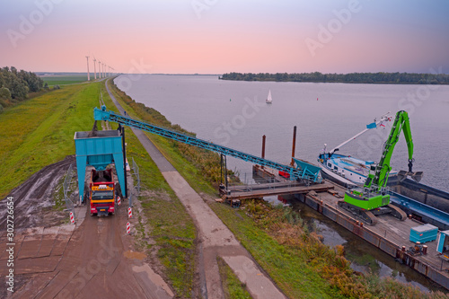 Valokuva  Aerial from freighter unloading sand in the countryside from the Netherlands