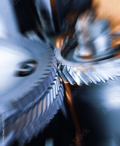 Fotografie, Tablou gear wheel is machined on a horizontal CNC machine center with  rotating tool an
