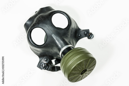 Old army surplus gas mask with white background.   #302735494