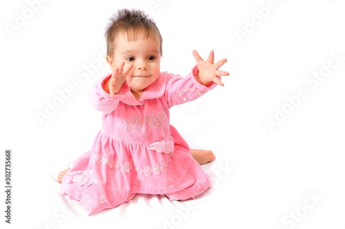 Photo Funny surprised little girl in pink dress plays with soap bubbles on white isolated background