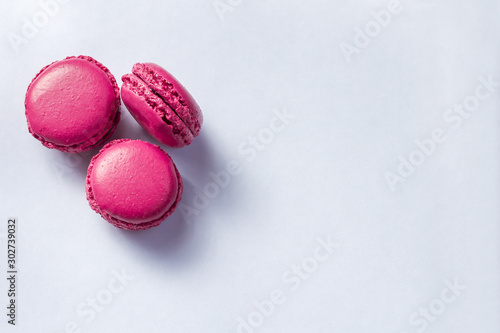 Colorful french macarons cookies(macaroons) on a light background with copy space for postcard, banner, cover Tableau sur Toile