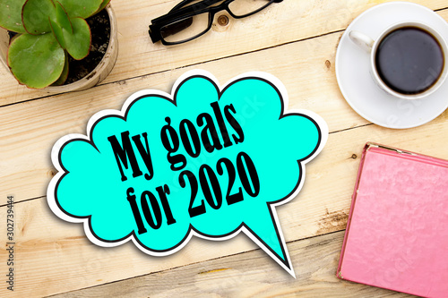 my goals for2020 on speech bubble on wooden table Wallpaper Mural