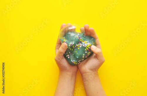 Obraz Child hands with slime on background. - fototapety do salonu