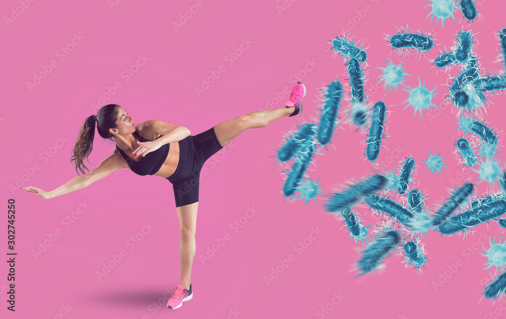 Fototapety, obrazy: Aggressive woman fights with a kick against bacteria and disease