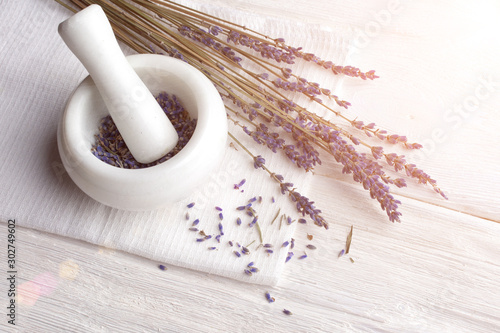 making organic cosmetics with dried lavender In marble mortar and pestle on white wooden background top view Fototapeta