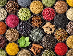 Bright spice background, top view. Collection  seasoning and herbs of Indian ...