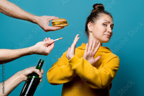 girl in bright clothes refuses junk food, alcohol and cigarettes Wallpaper Mural