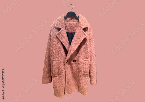 Stampa su Tela Fashionable Pink women Faux shearling coat on a hanger isolated on pink background