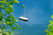 Scenery Of Sailboat On Bohinj Lake In Slovenia. Nature And Sailing Boat On River Water In Slovenija. Beautiful Landscape View In Summer. Alpine Travel Destination. Julian Alps Mountains