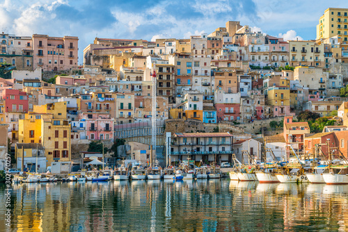 The colorful city of Sciacca overlooking its harbour. Province of Agrigento, Sicily.