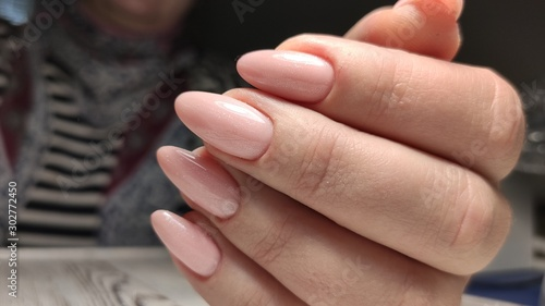 Obraz na plátně fashionable beige manicure with a silver design