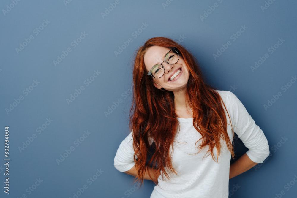 Fototapeta Happy attractive young redhead woman