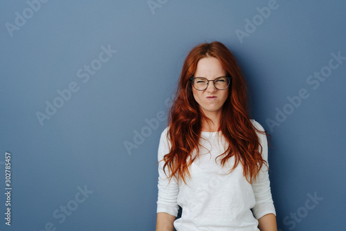 Young woman grimacing in revulsion and aversion Canvas Print