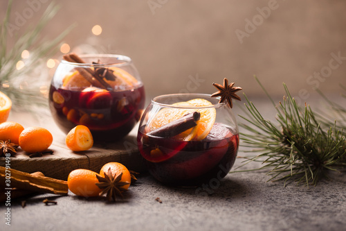 Obraz  Christmas mulled wine delicious holiday like parties with orange cinnamon star anise spices. Traditional hot drink or beverage, festive cocktail at X-mas or New Year - fototapety do salonu