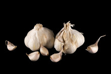 Duo Of Garlic Head And Pods, On Black Background