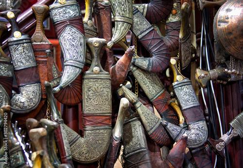 Wall of Bedouin knives for sale in Oman Market Wallpaper Mural