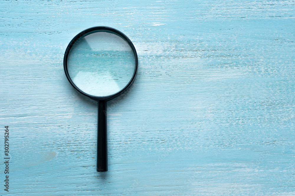 Fototapety, obrazy: Magnifier lies on a wooden background with a place for inscription. magnifying glass.