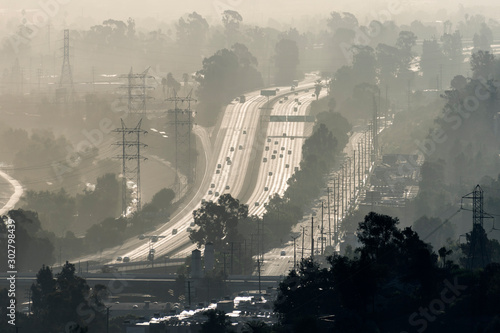 Hazy smoggy view of the 5 freeway near Riverside Drive, Griffith Park and the Los Angeles River in Southern California.   #302798439