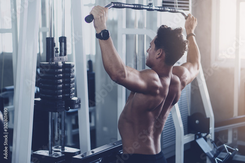Fotografie, Obraz  caucasian man in fitness having workout for bodybuilding with weights lifting us