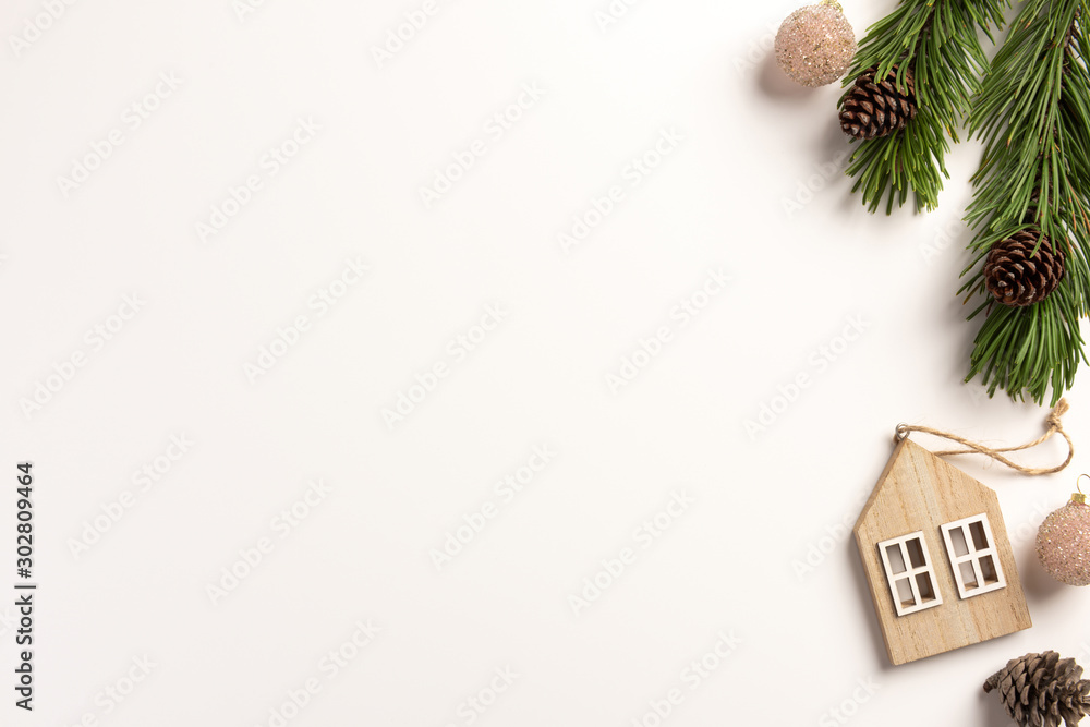 Fototapeta Minimal Christmas concept. Spruce branches with cones, on a white background. Flat lay, top view, copy space.