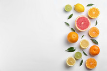 Flat Lay Composition With Tangerines And Different Citrus Fruits On White Background. Space For Text