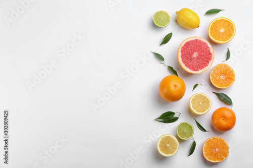 Fototapeta Flat lay composition with tangerines and different citrus fruits on white background