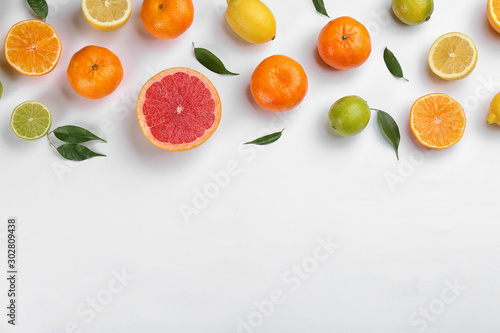 Fényképezés Flat lay composition with tangerines and different citrus fruits on white background