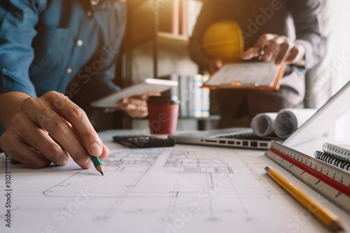 Creative architect projecting on the big drawings in the dark loft office or caf Canvas Print