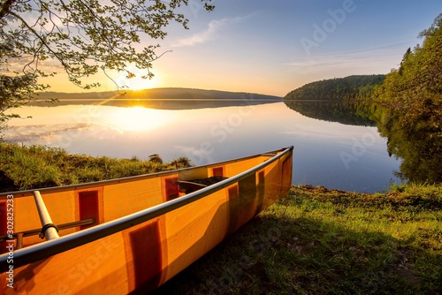 Canoe on the shore of the Boundary Waters in northern Minnesota Wallpaper Mural
