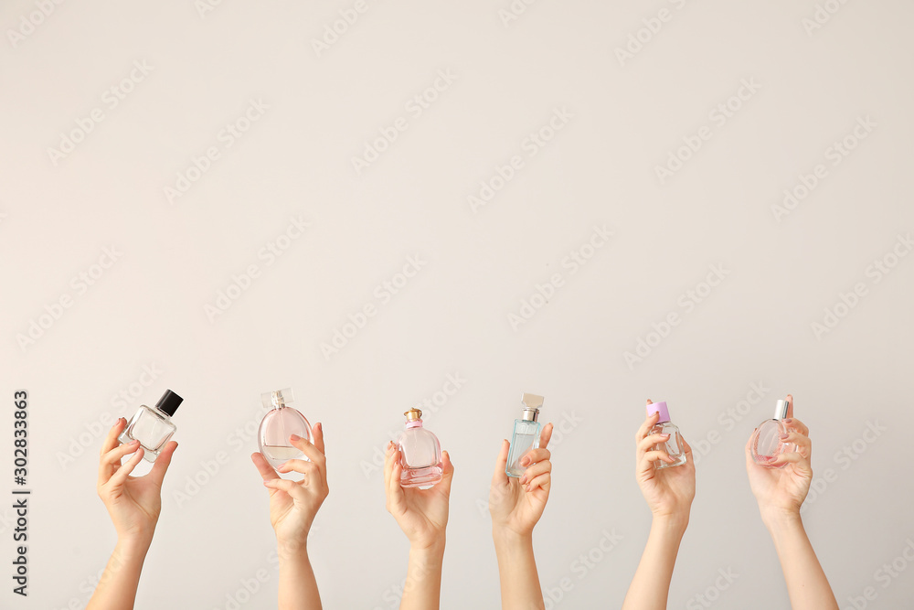 Fototapety, obrazy: Female hands with different perfume bottles on grey background