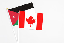 Canada And Jordan Stick Flags On White Background. High Quality Fabric, Miniature National Flag. Peaceful Global Concept.White Floor For Copy Space.