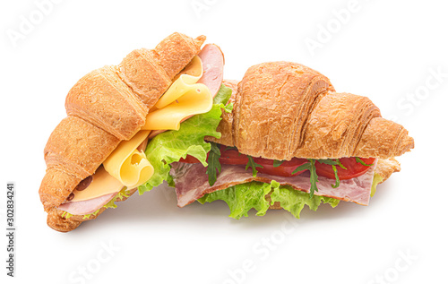 Tuinposter Snack Tasty croissant sandwiches on white background