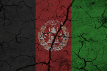 Afghanistan Flag On The Background Texture Of Cracked Earth. The Concept Of Design Solutions.