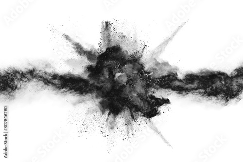 obraz PCV particles of charcoal on white background,abstract powder splatted on white background,Freeze motion of black powder exploding or throwing black powder.