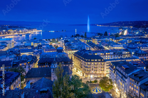 Aerial view of Geneva City center and Jet d'eau by night on World Diabetes Day Wallpaper Mural