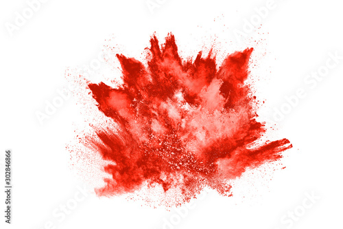 Fotografía  Freeze motion of red powder exploding, isolated on white background